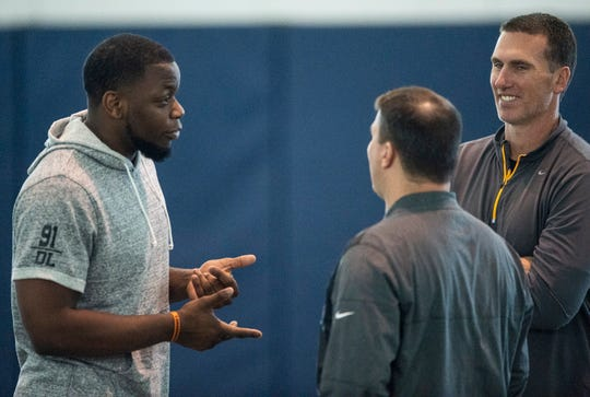 Auburn defensive lineman Nick Coe (91) talks with scouts during Auburn Pro Day at Auburn Athletic Complex in Auburn, Ala., on Friday, March 6, 2020.