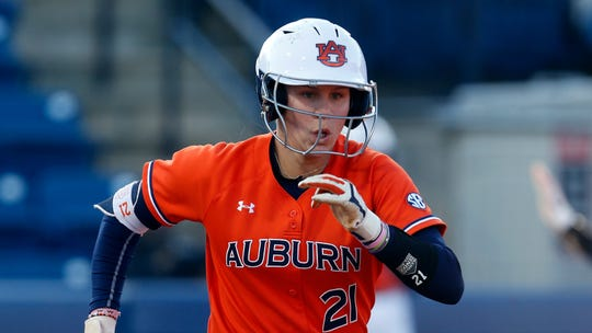 Auburn Alyssa Rivera (21) runs to first during an NCAA college softball game against Minnesota Saturday, Feb. 29, 2020, in Auburn, Ala. (AP Photo/Butch Dill)
