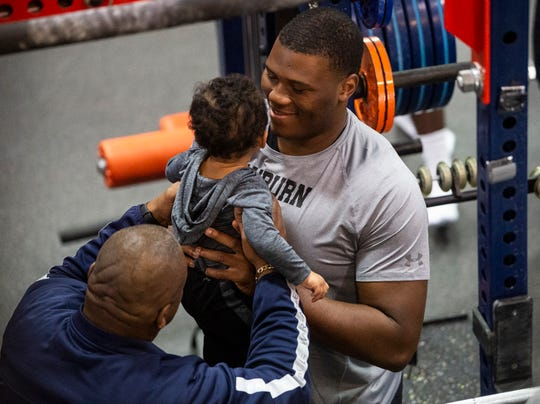 Auburn defensive lineman Derrick Brown (5) holds his son, Kai, during Auburn Pro Day at Auburn Athletic Complex in Auburn, Ala., on Friday, March 6, 2020.
