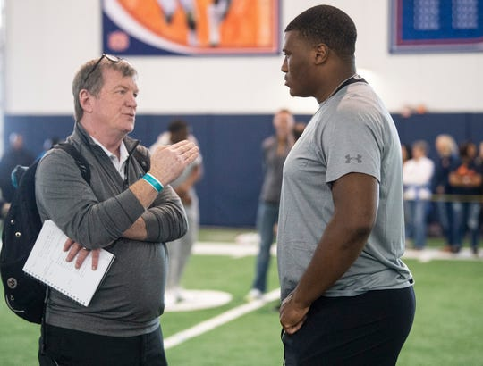 Auburn defensive lineman Derrick Brown (5) talks with scouts during Auburn Pro Day at Auburn Athletic Complex in Auburn, Ala., on Friday, March 6, 2020.