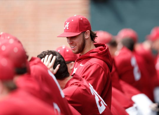 Alabama sophomore right-handed pitcher Connor Shamblin (29) talks to teammates during a game against Harvard on March 1, 2020, at Sewell-Thomas Stadium in Tuscaloosa.