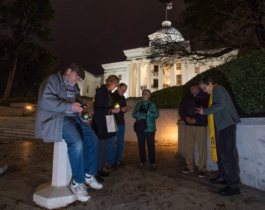 A small candlelight vigil for Nathaniel Woods, who is scheduled be executed, is held on the steps of the state capitol building in Montgomery, Ala., on Thursday evening March 5, 2020.