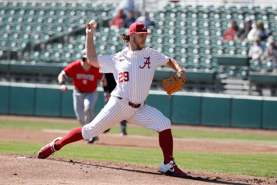 Alabama sophomore right-handed pitcher Connor Shamblin (29) delivers during a game against Northeastern on Feb. 15, 2020, at Sewell-Thomas Stadium in Tuscaloosa.