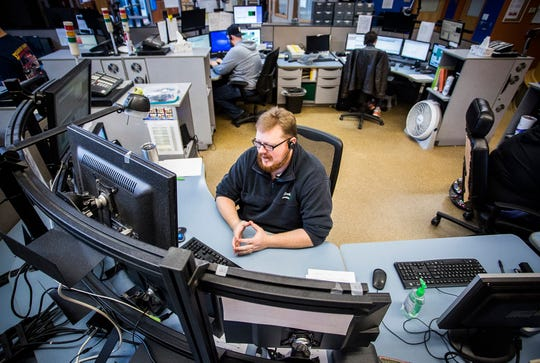 Delaware County Dispatch works an afternoon shift in downtown Muncie.