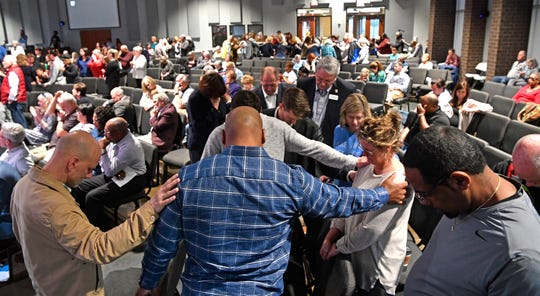 Worshipers gather during one of two community prayer services at Providence United Methodist Church in Mt. Juliet, Tenn. Thursday, March 5, 2020.