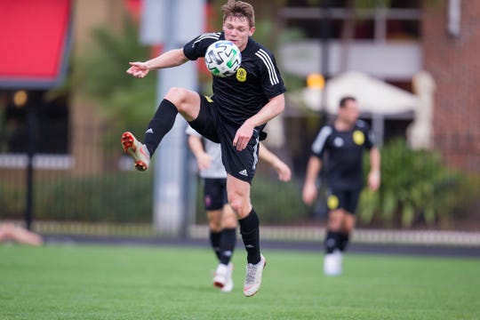 Luke Haakenson controls a lob pass during a Nashville SC preseason match against Chicago Fire FC at the University of Tampa on Feb. 6 2020.