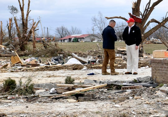 President Donald Trump speaks with Mike Herrick, of the  Putnam County Rescue Squad, during his visit to tornado-ravaged Putnam County, Tenn., March 6, 2020.