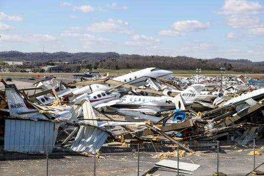 Damage to airplanes, hangars, and facilities all around the field left in the wake of a tornado can be seen at the John C. Tune Airport in Nashville, Tenn., on Friday, March 6, 2020.
