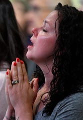 The tears flowed as Regina Girten and others worship during one of two community prayer services at Providence United Methodist Church in Mt. Juliet, Tenn. Thursday, March 5, 2020.