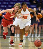 Baylor forward Emma Martin (34) and Ensworth guard Jaloni Cambridge (22) chase down a loose ball during the first half of the TSSAA Division II-AA State Basketball Championship semifinal game on Friday, March 6, 2020, in Nashville, Tenn.