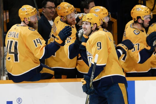 Nashville Predators left wing Filip Forsberg (9) is congratulated after scoring against the Dallas Stars in the first period on Thursday, March 5, 2020, in Nashville, Tenn.