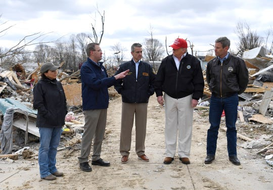 President Donald Trump chats with Tennessee first lady Maria Lee, Putnam County Mayor Randy Porter, Cookeville Mayor Ricky Shelton and Tennessee Gov. Bill Lee Friday, March 6, 2020 in Putnam County, Tenn. after tornadoes ripped through Middle Tennessee earlier in the week killing 25 people.