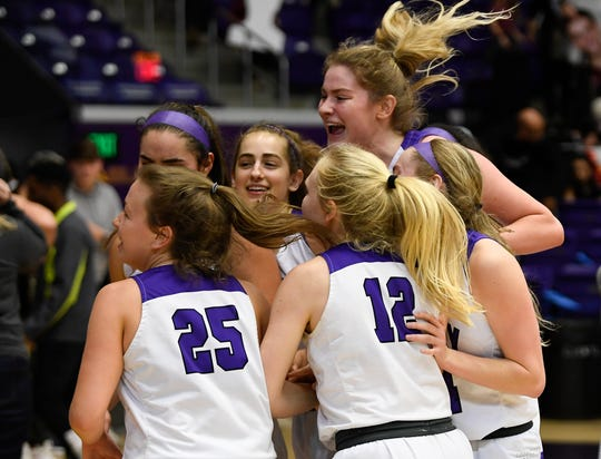 Trinity Christian celebrates their 64 to 59 overtime win over Tipton-Rosemark in the TSSAA Division II State Basketball Championship semifinal game at Allen Arena Thursday, March 5, 2020 in Nashville, Tenn.