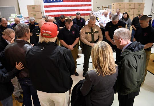 Gov. Bill Lee leads a prayer with President Donald Trump, U.S. Sens. Marsha Blackburn and Lamar Alexander, and first responders at Jefferson Avenue Church of Christ in Cookeville, Tenn., on Friday, March 6, 2020.