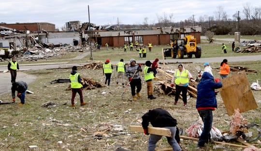 Volunteers clean up debris at Mt. Juliet Christian Academy on Friday, March 6, 2020, in Mt Juliet, Tenn., following the tornado that moved through area Tuesday.