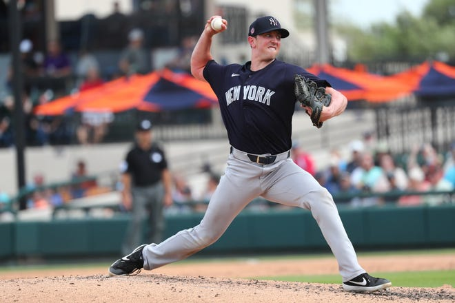 Mar 5, 2020; Lakeland, Florida, USA;  New York Yankees relief pitcher Brooks Kriske (82) throws a pitch during the third inning against the Detroit Tigers at Publix Field at Joker Marchant Stadium.