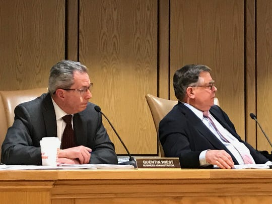 Mahwah Administrator Quentin Wiest and Mayor John Roth explain their position on garbage collection at Thursday's council meeting.
