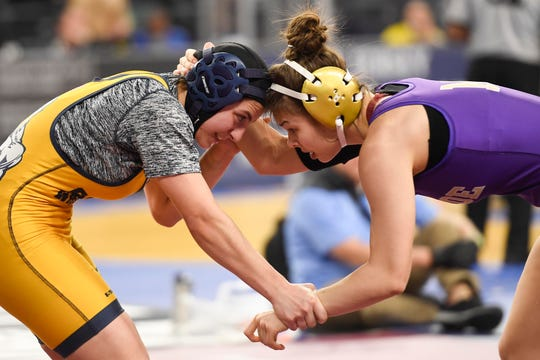 Brooke Tulloch of Saddle Brook, left, and Gabby Miller of Monroe wrestle in the 135-pound quarterfinal on Day 1 of the NJSIAA State Wrestling Championships at Boardwalk Hall in Atlantic City on Thursday, March 5, 2020.