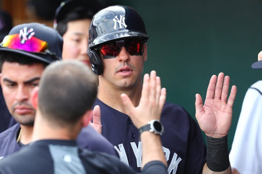 Mar 5, 2020; Lakeland, Florida, USA;  New York Yankees center fielder Mike Tauchman (39) is congratulated in the dugout after scoring a run during the third inning  against the Detroit Tigers at Publix Field at Joker Marchant Stadium.