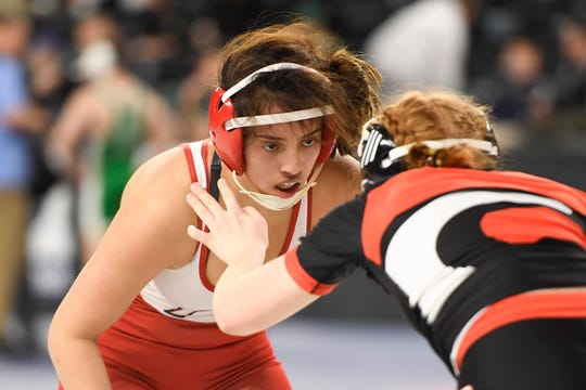 Natalie Vega of Elmwood Park, left, wrestles Skyelar Smith of Jackson in the 135-pound quarterfinal on Day 1 of the NJSIAA State Wrestling Championships at Boardwalk Hall in Atlantic City on Thursday, March 5, 2020.