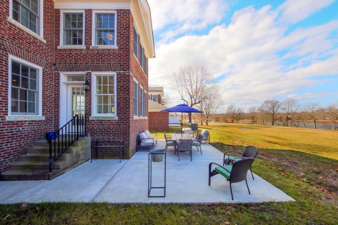 Remodeled for modern living, the historic homes on Officer's Row at East Gate on the former Fort Monmouth army post feature spacious backyards and offer waterfront views. The homes are priced from the upper $700,000s.