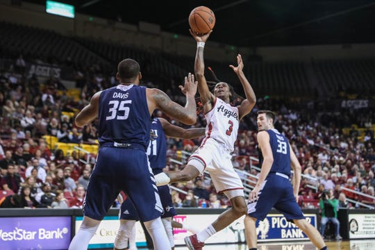 NMSU senior Terrell Brown (3) shoot the ball as the New Mexico State Aggies face off against the Cal Baptist Lancers at the Pan American Center in Las Cruces on Thursday, March 5, 2020.