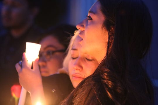 Antonio Valenzuela's daughters Isis and Alexis Valenzuela hug each other during a candlelight vigilnThursday March 5, 2020, in memory of their father, who died Feb. 29, 2020, after an altercation with police. Alexis said her father was not a violent man.