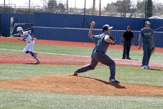 Ruidoso's Richardo Garcia pitches while Carlsbad steals a base during their game on March 6, 2020.