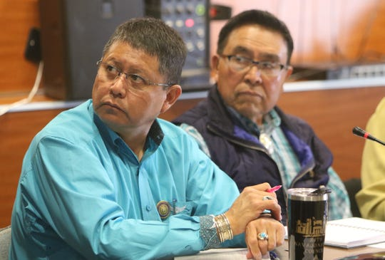 Delegates Wilson Stewart Jr., left, and Jimmy Yellowhair listen to comments during the Navajo Nation Council's public hearing on uranium mining on March 5 Diné College's south campus in Shiprock.
