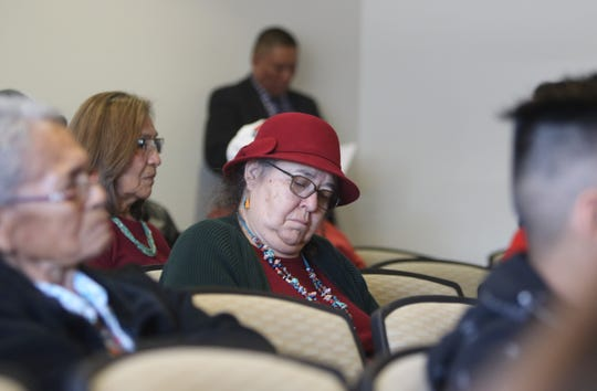 San Juan County Commissioner GloJean Todacheene takes notes during the Navajo Nation Council's public hearing on uranium mining on March 5 at Diné College's south campus in Shiprock.