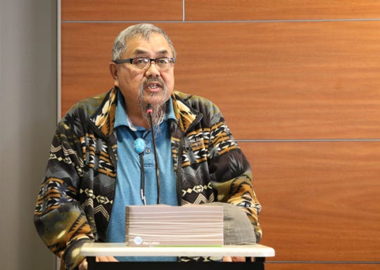 Perry Charley, a northern regional representative for the Diné Uranium Remediation Advisory Commission, provides comments during a public hearing by the Navajo Nation Council about uranium mining on March 5 at Diné College's south campus in Shiprock.