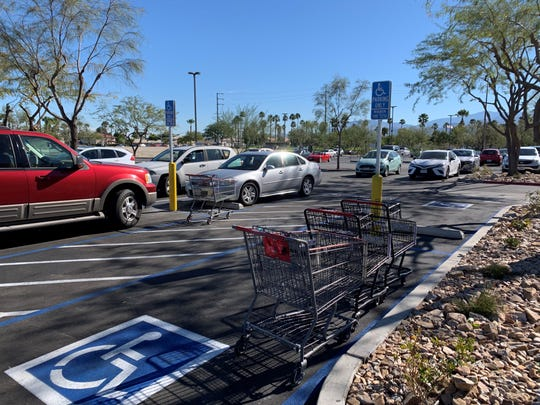 Shopping carts block a parking space at a valley shopping center.