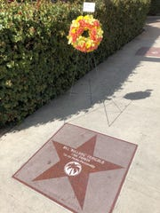 A wreath, honoring Bill Feingold after his death, is placed on his star in downtown Palm Springs on March 6, 2020.