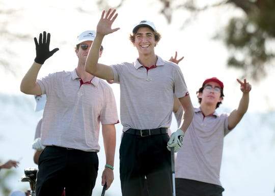 Palm Desert High School golfers wave before teeing off on the Pete Dye Course at Westin Mission Hills in Rancho Mirage, Calif., on Thursday, March 5, 2020.