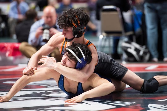 Central York's Mason Myers (top) wrestles Kennett's Trent Kochersperger during the PIAA 3A 132-pound consolations at the Giant Center in Hershey Friday, March 6, 2020. Myers won, 6-5.