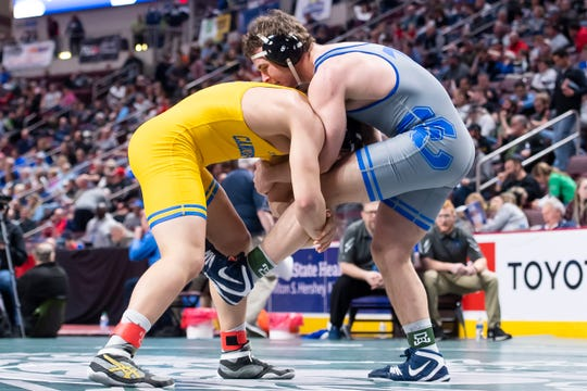 Cedar Crest's T.J. Moore (right) wrestles Canon-McMillan's Evan Miller during the PIAA 3A 220-pound consolations at the Giant Center in Hershey Friday, March 6, 2020. Moore won, 11-5.
