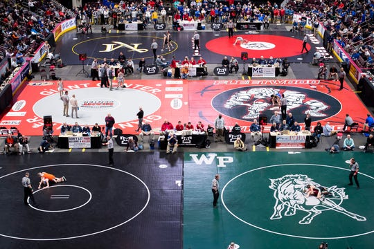 Wrestlers battle on six mats inside the Giant Center during the PIAA 3A quarterfinals and consolations in Hershey Friday, March 6, 2020.