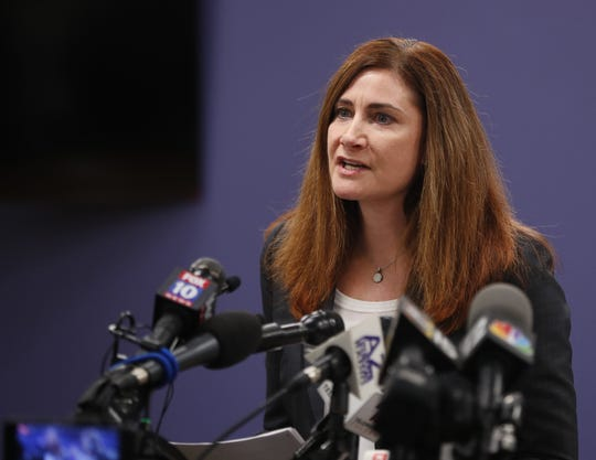 Rebecca Sunenshine (left), medical director for disease control, speaks during a press conference about a third presumptive positive case of COVID-19 at Maricopa County Administration in Phoenix, Ariz., on March 6, 2020.