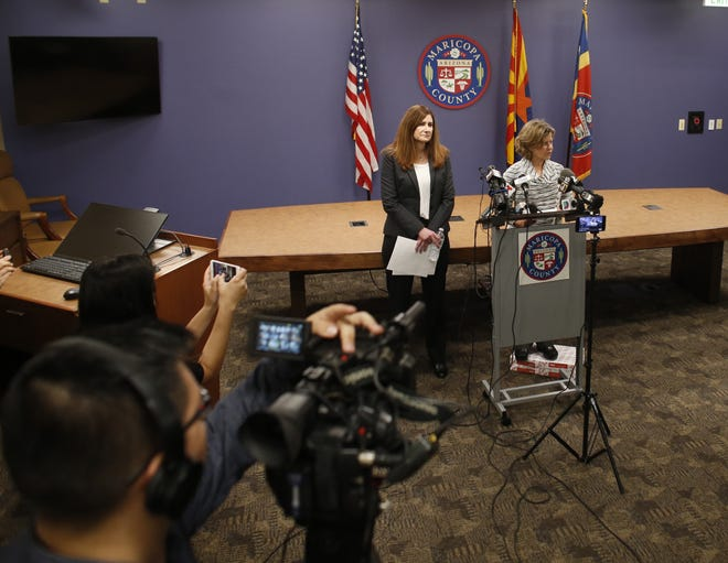 Rebecca Sunenshine (left), Maricopa County's medical director for disease control listens during a press conference on March 6, 2020.