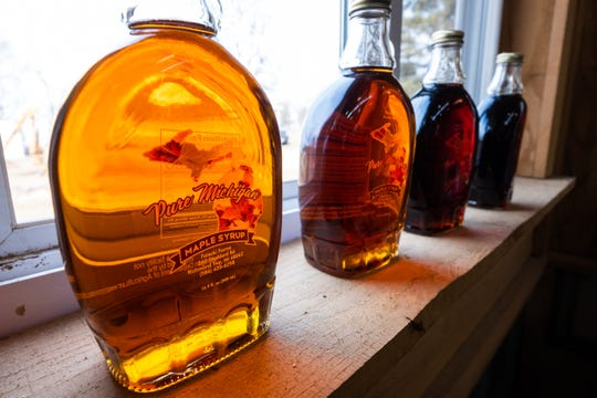 Jars of maple syrup are lined up on the windowsill of the sugar house at Falecki Farms in Richmond Township.
