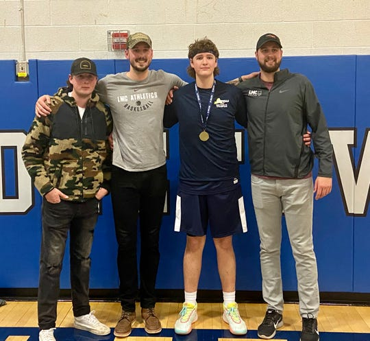 The Lydon brothers pose together after Logan Lydon helped the Pine Plains boys basketball team win a Section 9 Class C title on Thursday. From left: Jake Lydon, Tyler Lydon, Logan Lydon and Zach Lydon.