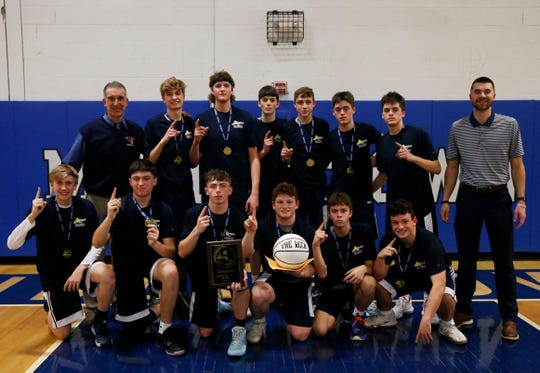 The Pine Plains boys basketball team pose with the game ball and plaque after winning the Section 9 boys basketball championship in Middletown on March 5, 2020.