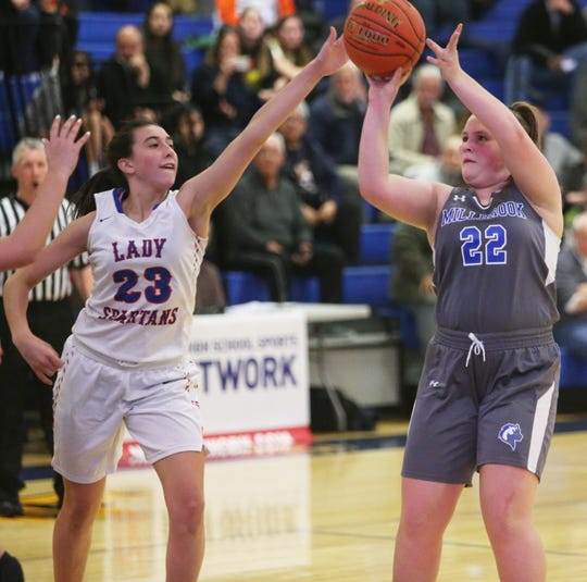 Millbrook's Ella Wilson takes a shot as S.S. Seward's Shannon Sgombick tries to block her during the Section 9 girls basketball championship in Middletown on March 5, 2020.