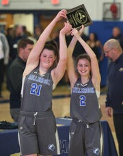 Millbrook's, from left, Erin Fox and Madison Harkinder hoist the Section 9 championship plaque after defeating  S. S. Seward in the Section 9 girls basketball championship in Middletown on March 5, 2020.