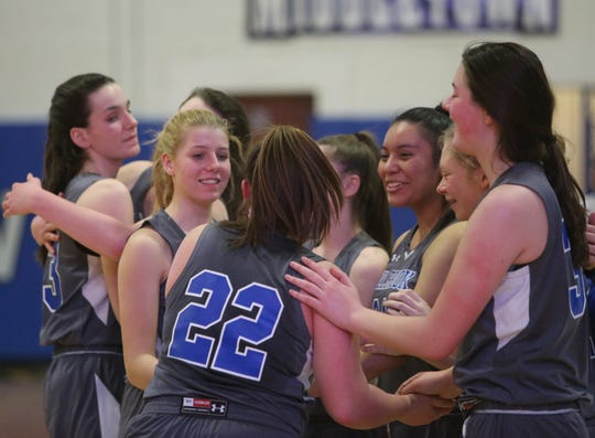 The Millbrook girls basketball team celebrates after beating S.S. Seward to capture the Section 9 Class C championship on March 5.