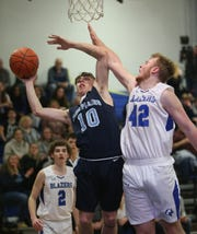 Pine Plains' Caleb McCaul goes for a layup against Millbrook's Tucker Giles during the Section 9 boys basketball championship in Middletown on March 5, 2020.