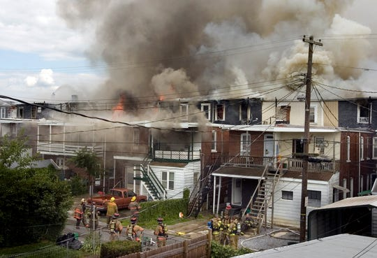 Fire spreads through a city block of homes on Chestnut Street, Wednesday, July 8, 2009. Fifteen structures were severely damaged and dozens of people were left homeless in the row house blaze.John Pavoncello photo