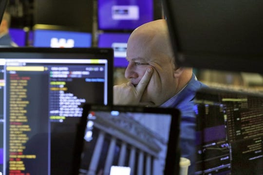 A trader studies his screens as he prepares for the day's activities on the floor of the New York Stock Exchange, Friday, March 6, 2020. (AP Photo/Richard Drew)