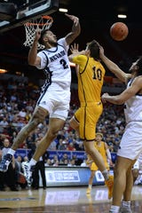 Wyoming Cowboys forward Hunter Thompson (10) has his shot blocked by Nevada Wolf Pack guard Jalen Harris (2) during the first half of a Mountain West Conference tournament game at Thomas Mack Center