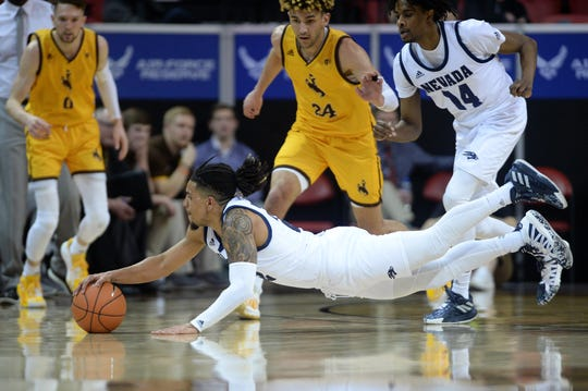 Nevada Wolf Pack guard Jazz Johnson (22) dives for a loose ball during the second half of a Mountain West Conference tournament game against the Wyoming Cowboys at Thomas Mack Center.